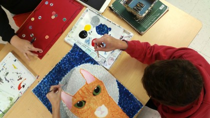 student working on cat painting