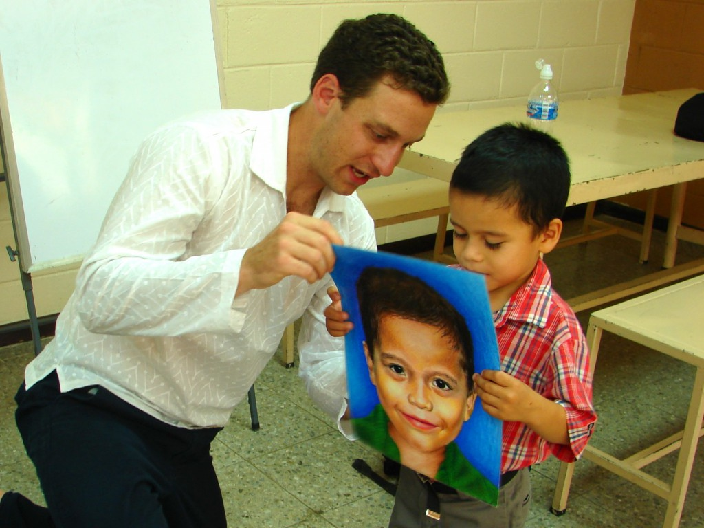 Ben with child receiving a portrait