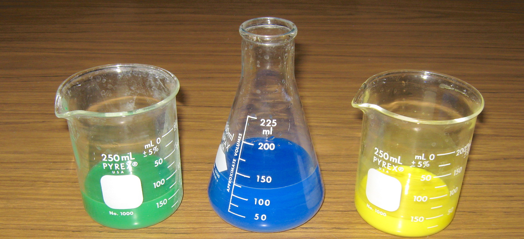 beakers with different colors of liquid