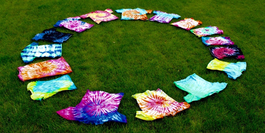 tie-dye shirts laid out in a circle