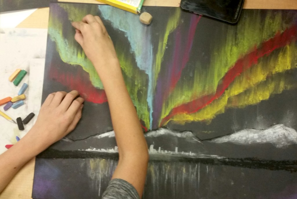 student working with chalk