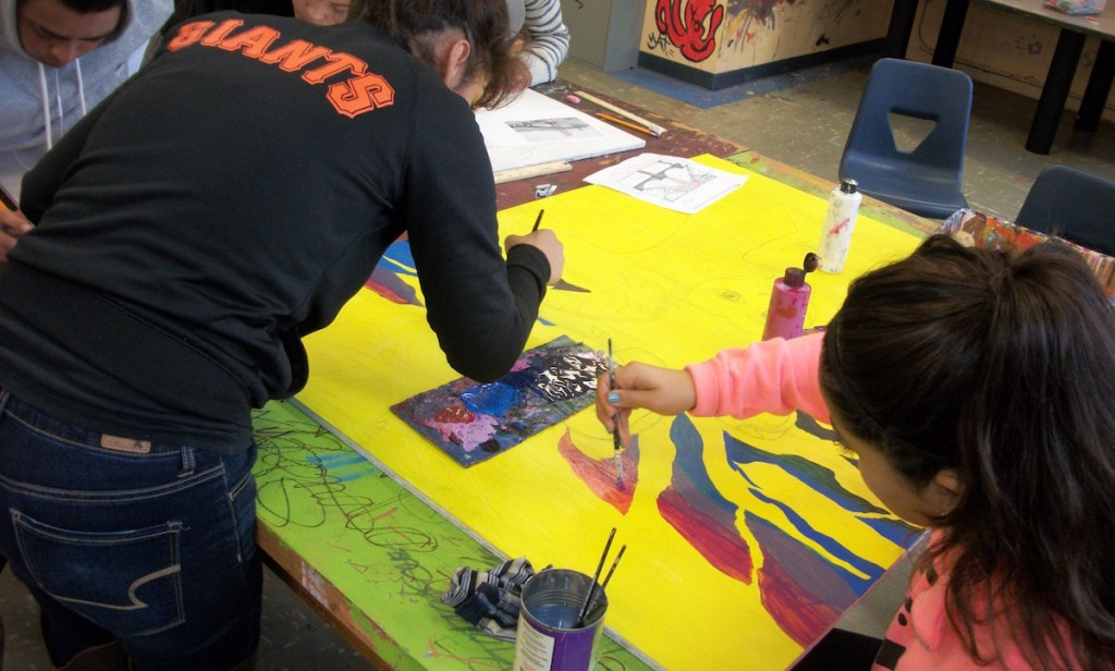 students collaborating on painting