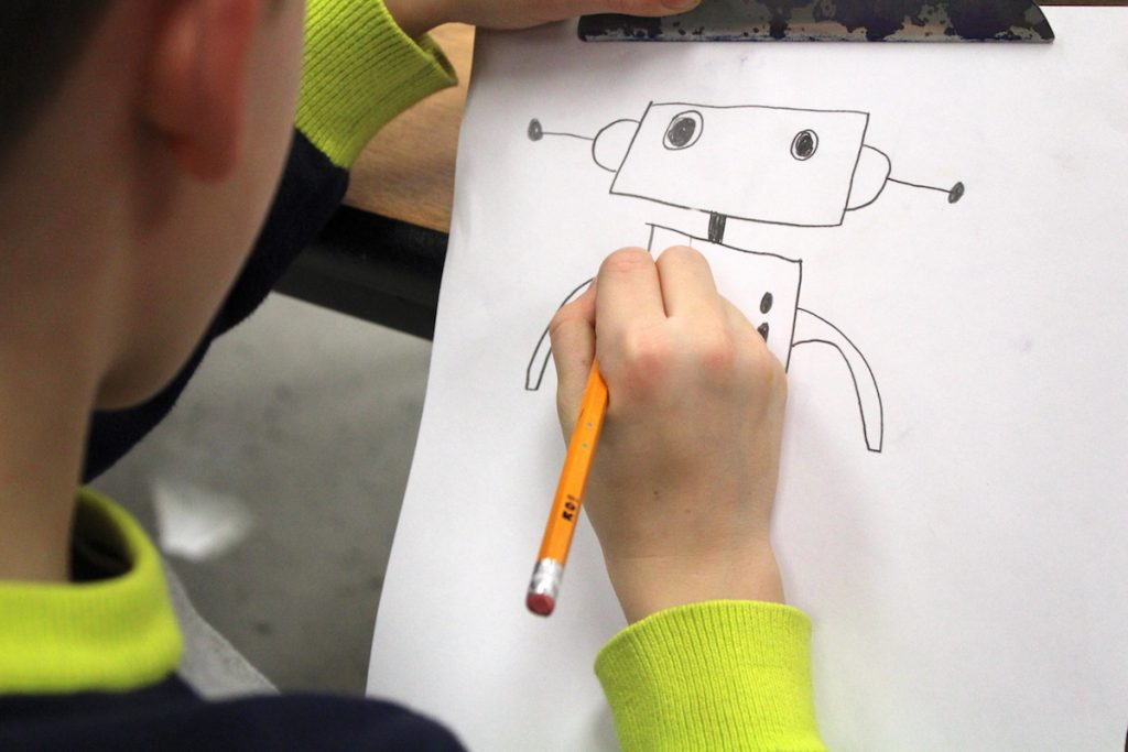 student drawing robot