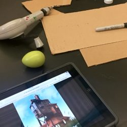 cardboard pieces with iPad showing a house