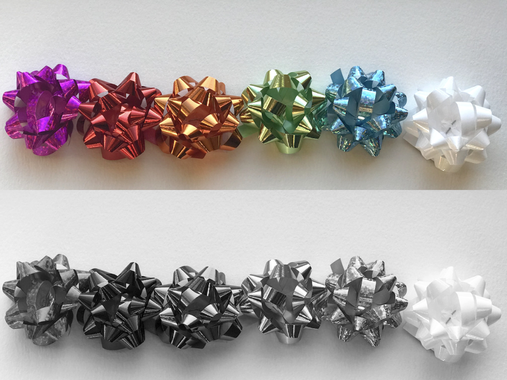 color photo and black and white photo of present bows arranged by value
