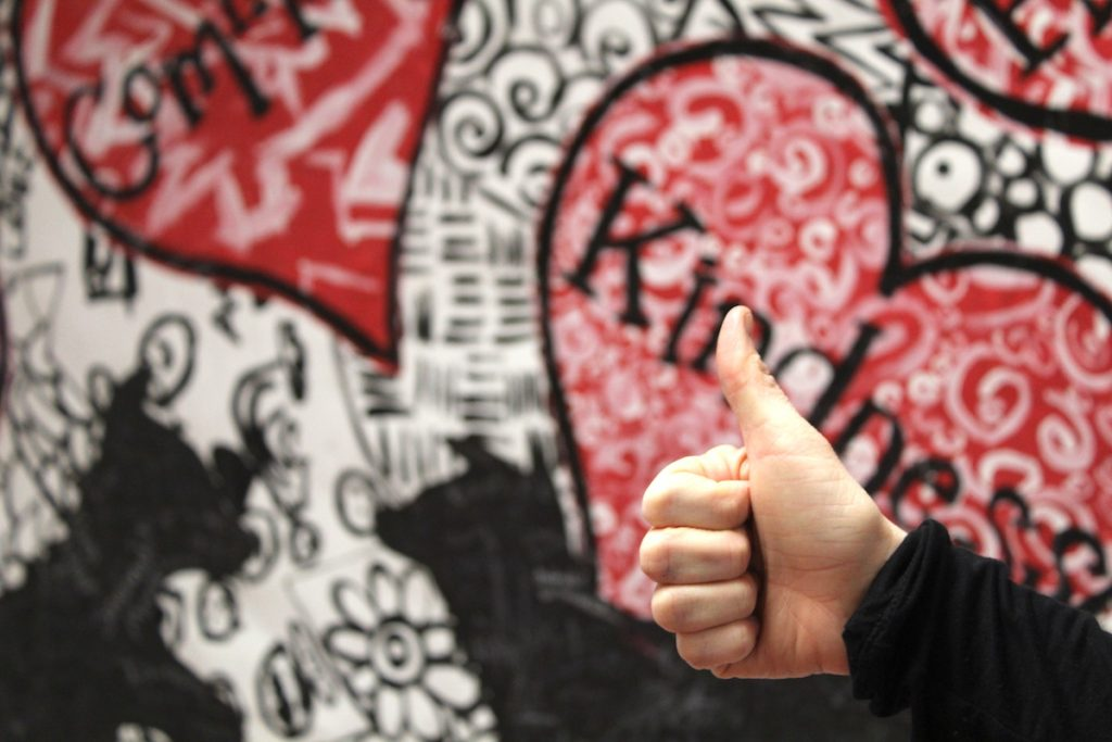 thumbs up in front of bulletin board
