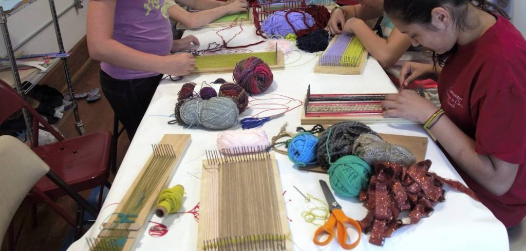students working on weaving