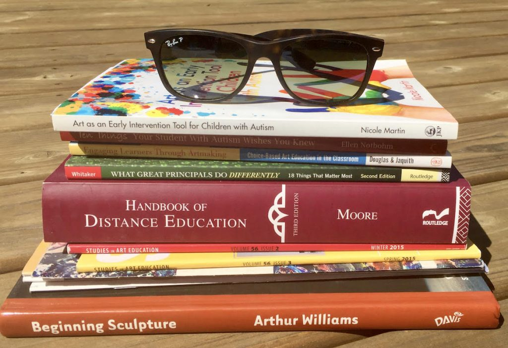 stack of PD books with sunglasses on top