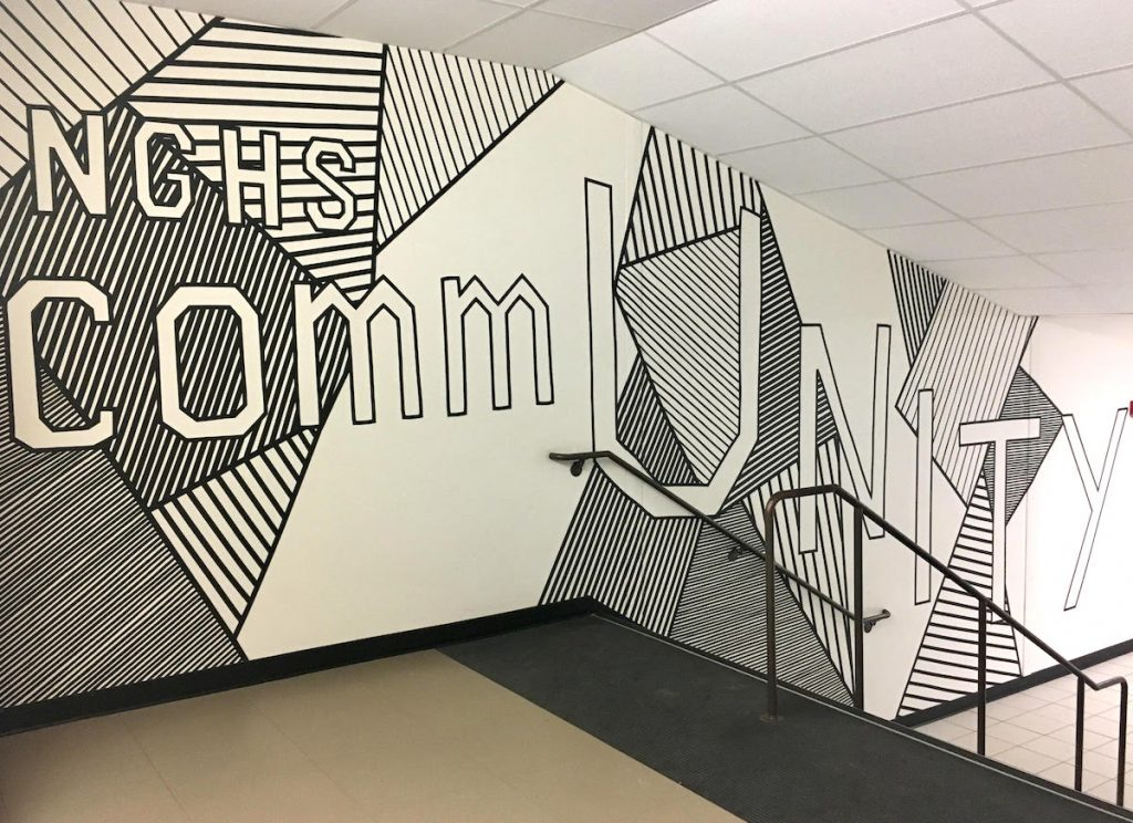 large tape mural with theme of community