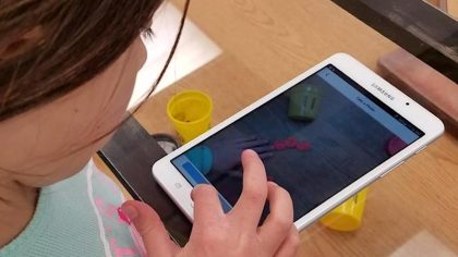 girl using ipad to document artwork