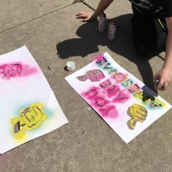student spray painting