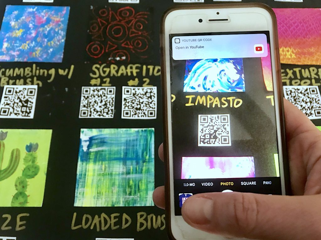 scanning QR code on interactive anchor chart