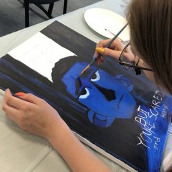 student creating artwork