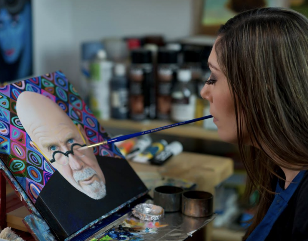 Pare working on a painting of Chuck Close