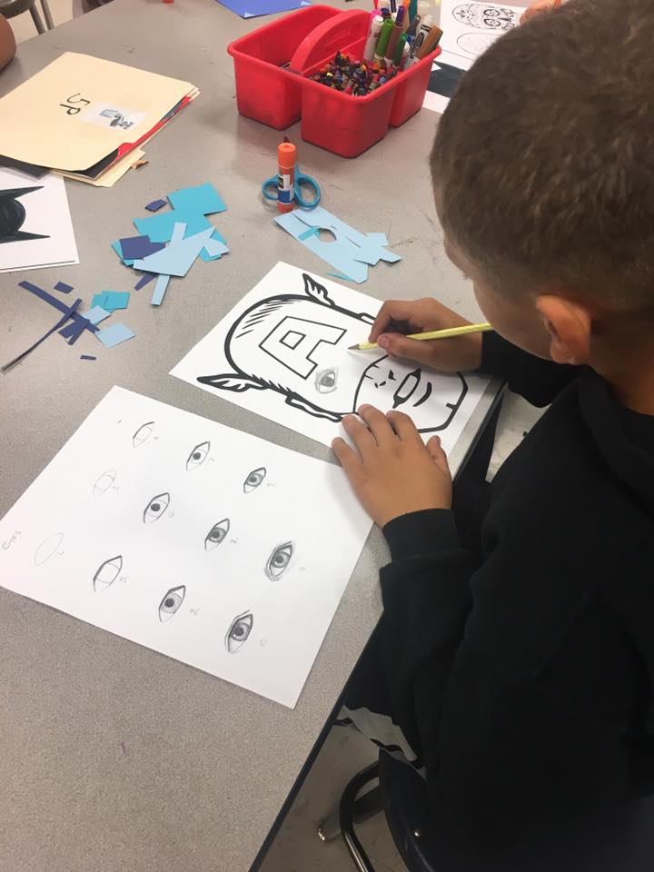 student working on drawing