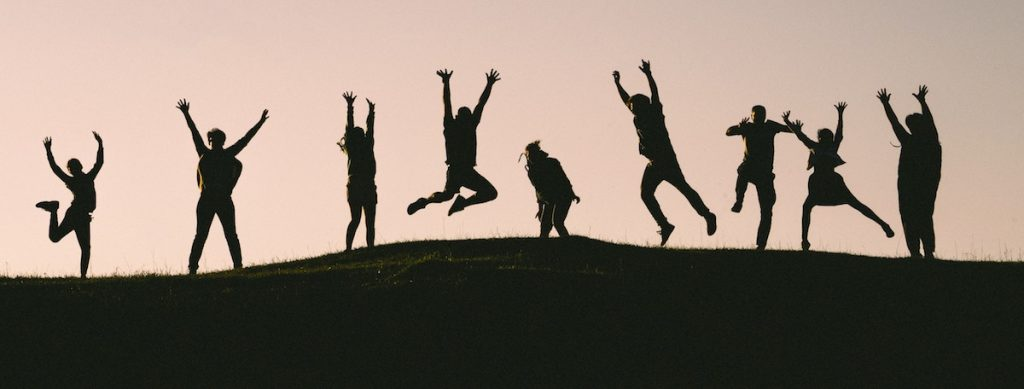 kids jumping in silhouette