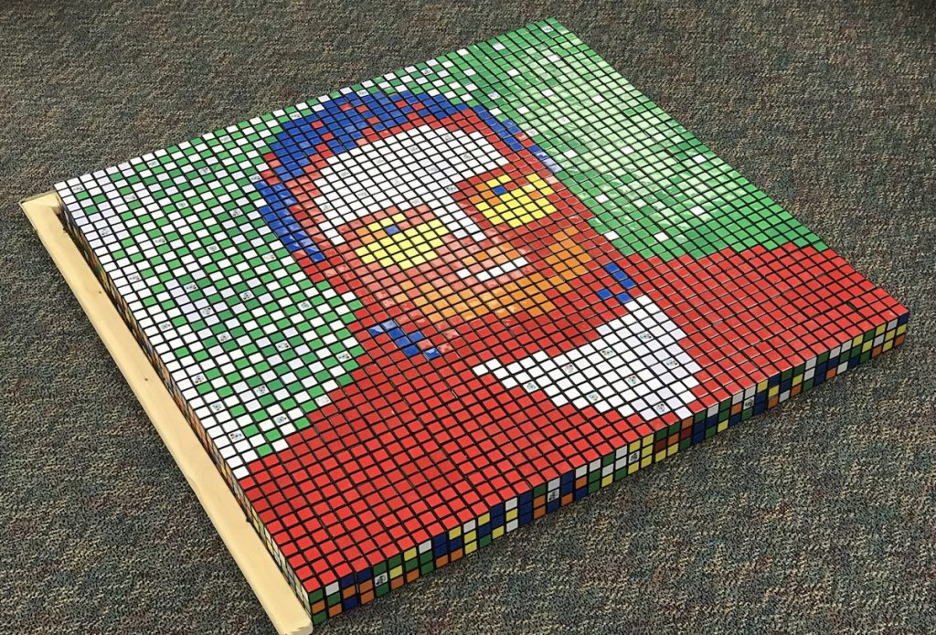 Completed Rubik's Cube Portrait of Person