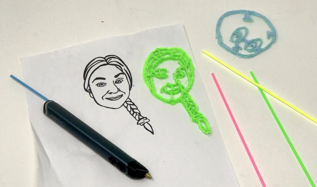 image of a 3D pen with drawing and print of a woman's face
