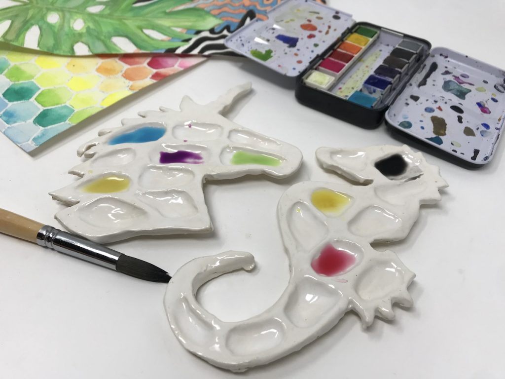 Ceramic paint palettes in shape of unicorn and sea horse