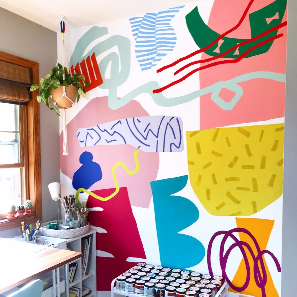 studio space with abstract mural on the wall