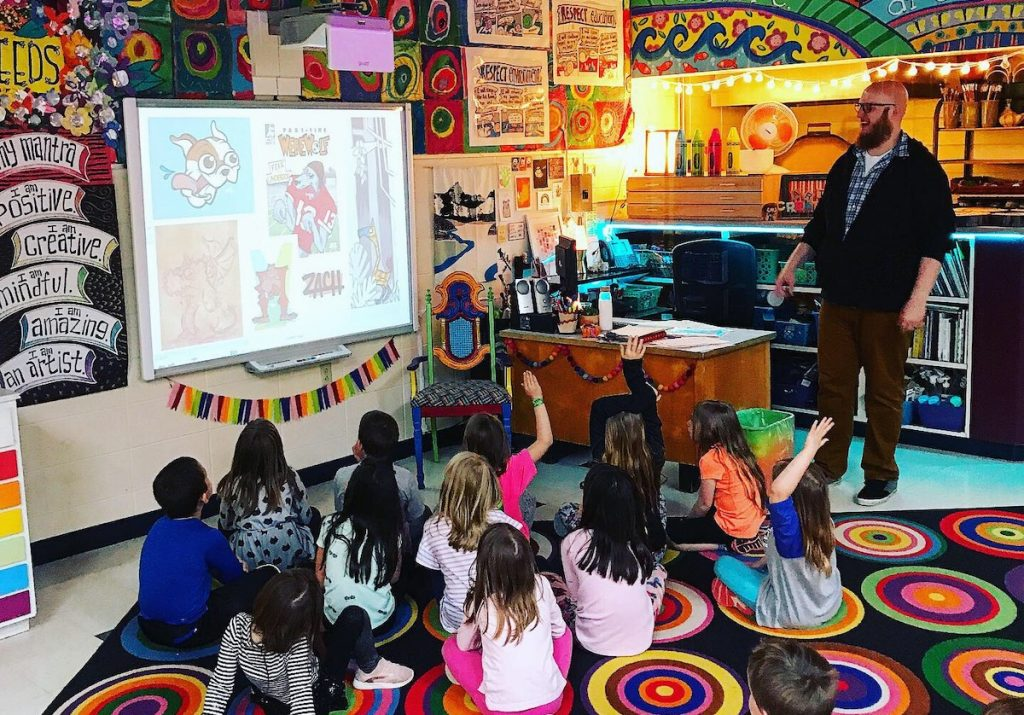 Picture of artist speaking to elementary classroom
