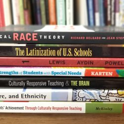 image of books about marginalized identities