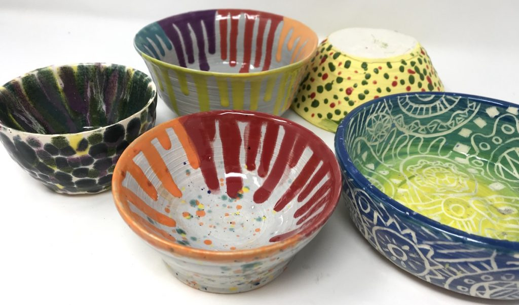colored bowls that were created by throwing them on the wheel