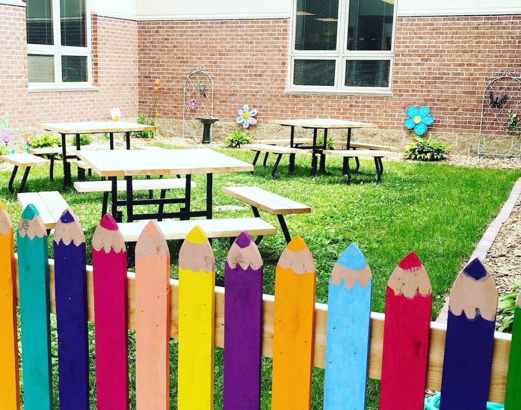 fence painted to look like colored pencils