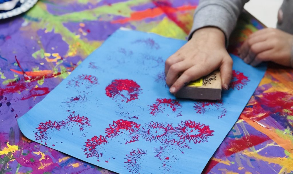 Student making marks on paper