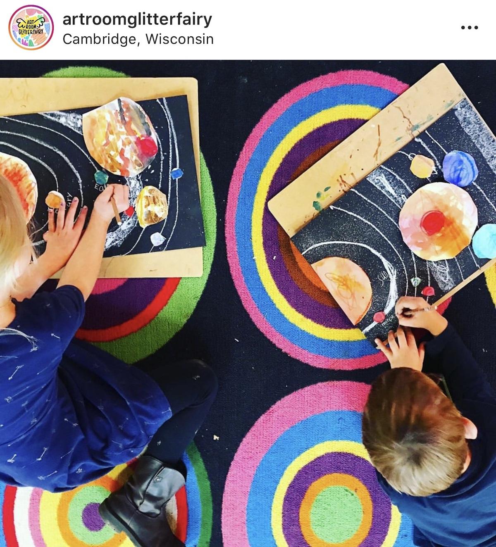 image of two kids making art