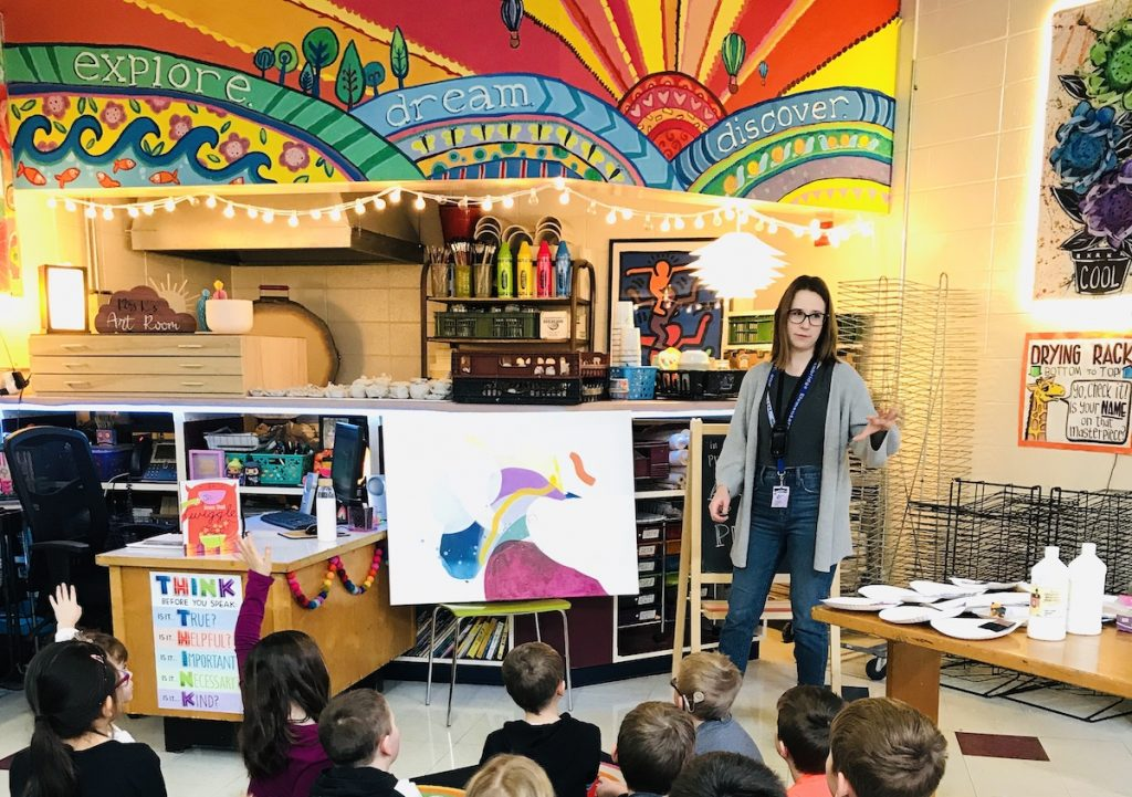 Artist talking to students