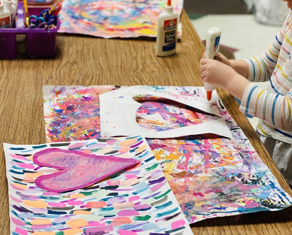 student working on heart artwork
